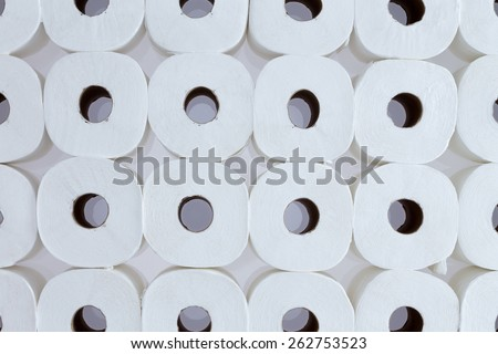 Full frame background pattern of white toilet paper rolls arranged in neat rows viewed from above - Toilet paper for everyone - stock photo
