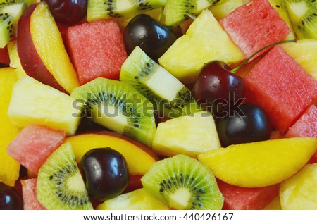 Full frame colorful variety of fruits. water melon,kiwi,banana,pineapple,cherry and nectarine   - stock photo