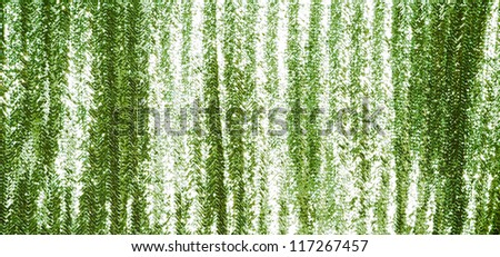 Full frame green sequins curtain background texture. - stock photo