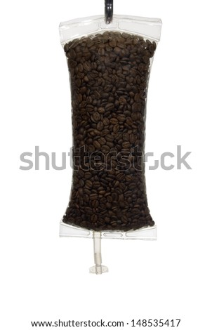 Full frame image of coffee beans in an IV bag as a metaphor for Coffee as a drug. - stock photo
