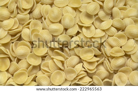 full frame italian pasta background with lots of Orecchiette noodles - stock photo