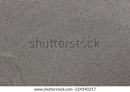 Full frame of gray sand at a greek beach - stock photo