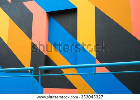 Full frame take of a facade painted with a geometric pattern - stock photo