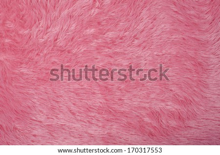 Full frame take of furry pink fleece fabric - stock photo