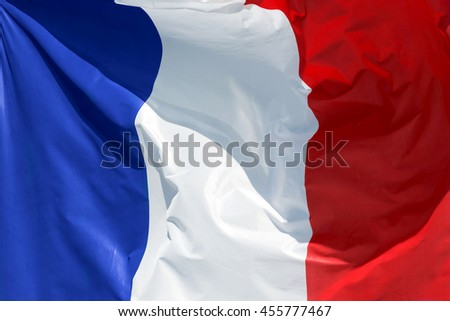 full framed french flag floating in the wind exact colors - stock photo
