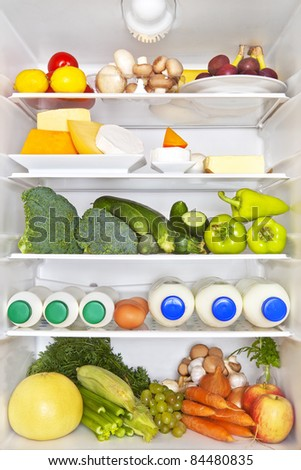 Full fridge of fruits, vegetables and diary products. Fresh healthy fitness eating concept. - stock photo