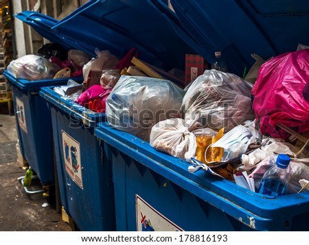 Full garbage containers - stock photo
