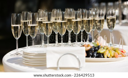 Full glasses of champagne on table - stock photo