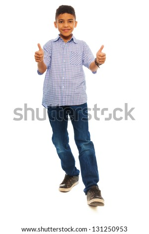 Full height portrait of black school boy with thumbs up, standing isolated on white - stock photo