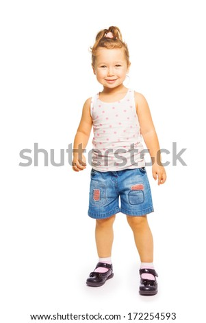 Full height portrait of happy smiling Asian 4 years old girl standing isolated on white - stock photo