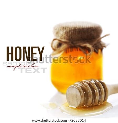 Full honey pot and honey stick over white (with sample text) - stock photo
