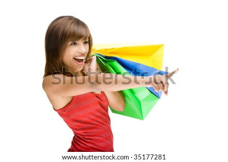 Full isolated portrait of a beautiful african woman with some shopping bags - stock photo