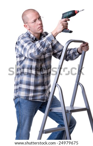 Full isolated studio picture from a young craftsman on a ladder with a cordless screwdriver - stock photo