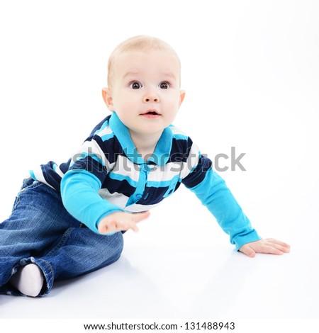 full legth portrait of cute happy smiling little boy toddler sitting in studio, 11 month, studio over white - stock photo