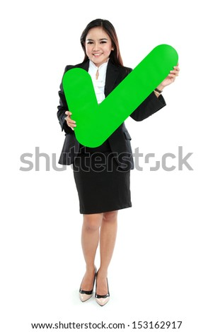 Full lenght of businesswoman holding check mark sign on white background - stock photo