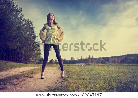 Full Lenght Portrait of Sexy Brunette Woman Standing on the Road. Toned Photo. - stock photo