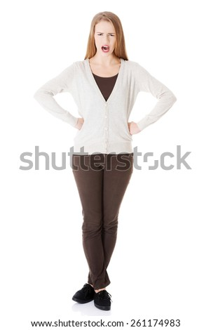Full length angry woman shouting. - stock photo