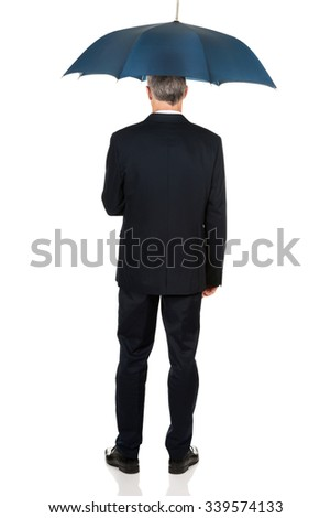 Full length back view businessman with umbrella. - stock photo