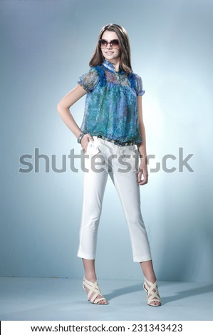 Full length Beautiful girl on light background/ Studio shot - stock photo
