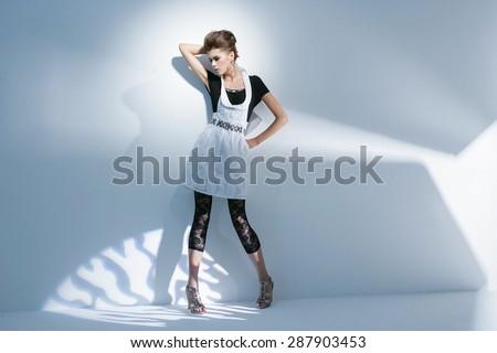 Full length Beautiful hairstyle girl on light background/ Studio shot  - stock photo