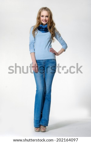 full-length beautiful young woman in jeans a standing over white background - stock photo