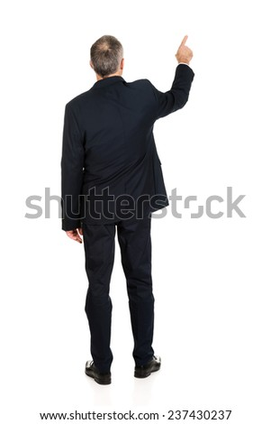 Full length businessman pointing upwards. - stock photo