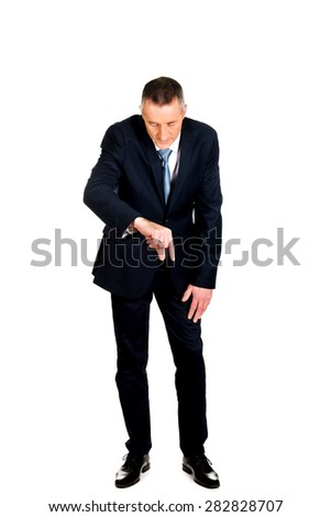 Full length businessman showing small size with fingers. - stock photo