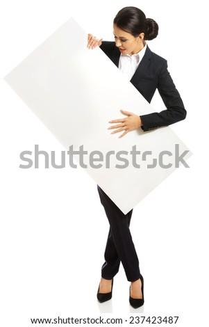 Full length businesswoman holding white banner. - stock photo