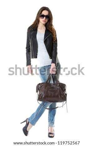 Full length casual fashion women wearing sunglasses posing shot in studio - stock photo