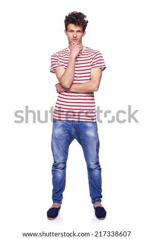 Full length casual trendy man with modern haircut posing in jeans and striped tshirt, over white background - stock photo