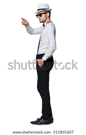 Full length elegant man  pointing to the side at blank copy space, over white background. - stock photo