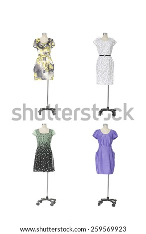 full-length evening gown clothing on four mannequin isolated - stock photo