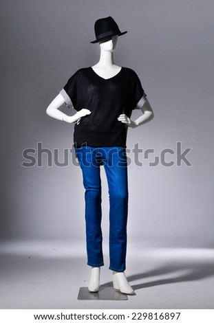 Full length Fashion female clothing in hat on mannequin in light background - stock photo