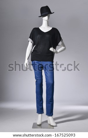 full-length Fashion female in jeans with hat on mannequin in light background - stock photo