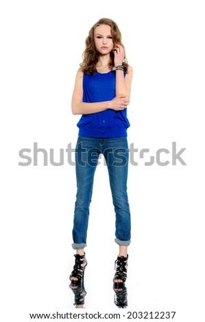 Full length fashion model in jeans posing in studio - stock photo
