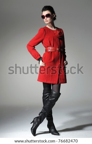 full-length fashion model in red clothes posing - stock photo
