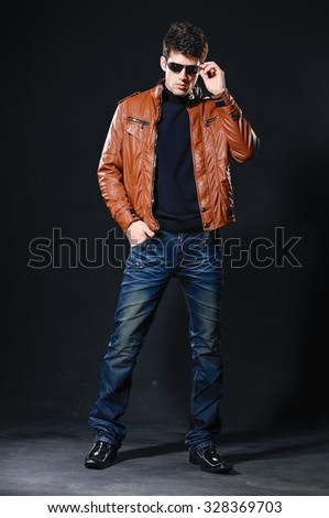 full length fashion Shot of a young man a professional model with sunglasses - stock photo