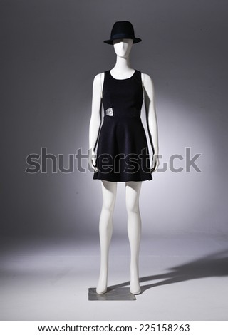 full-length female clothing in black dress with black hat on mannequin  - stock photo