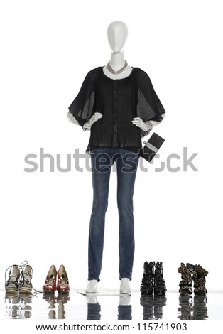 full-length female clothing with boots and bag on mannequin - stock photo