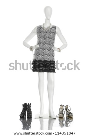 full-length female clothing with boots on mannequin - stock photo