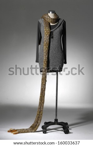 Full length female clothing with scarf on mannequin in light background  - stock photo