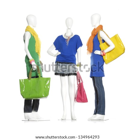 Full-length female dress with handbag and scarf on three mannequin - stock photo