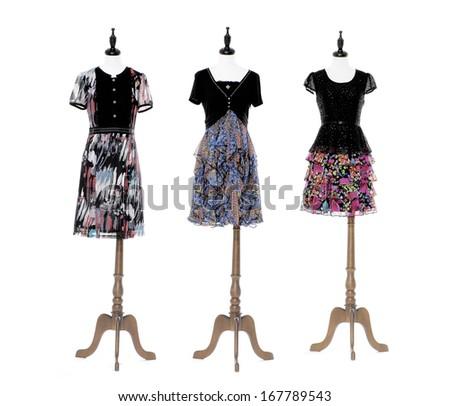 full-length female evening dress on three dummy isolated on white background  - stock photo