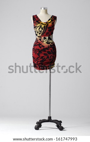 full length female fashion dress on mannequin-gray background - stock photo