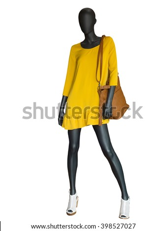 Full-length female mannequin dressed in yellow dress isolated on white background. - stock photo