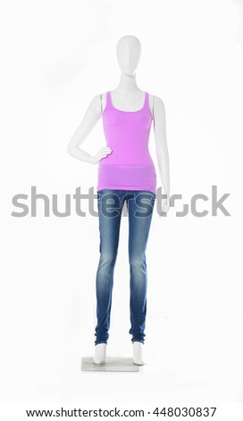 full-length female mannequin pink shirt dressed in jeans    - stock photo