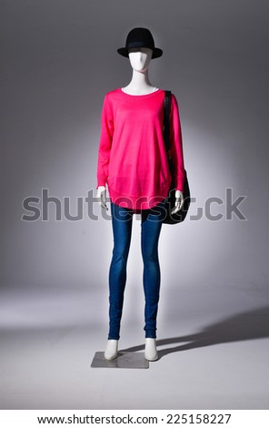 full-length female red clothing in jeans with black cap  - stock photo