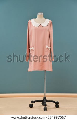full-length female sundress on a mannequin-blue background   - stock photo