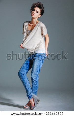 full-length girl in jeans, posing isolated   - stock photo