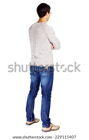 Full length half turn back view portrait of man in glasses and beige sweater with crossed arms on his chest isolated on white background - stock photo